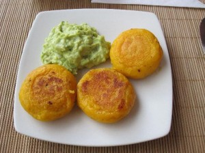Llapingachos-cheese and corn patties served with avocado