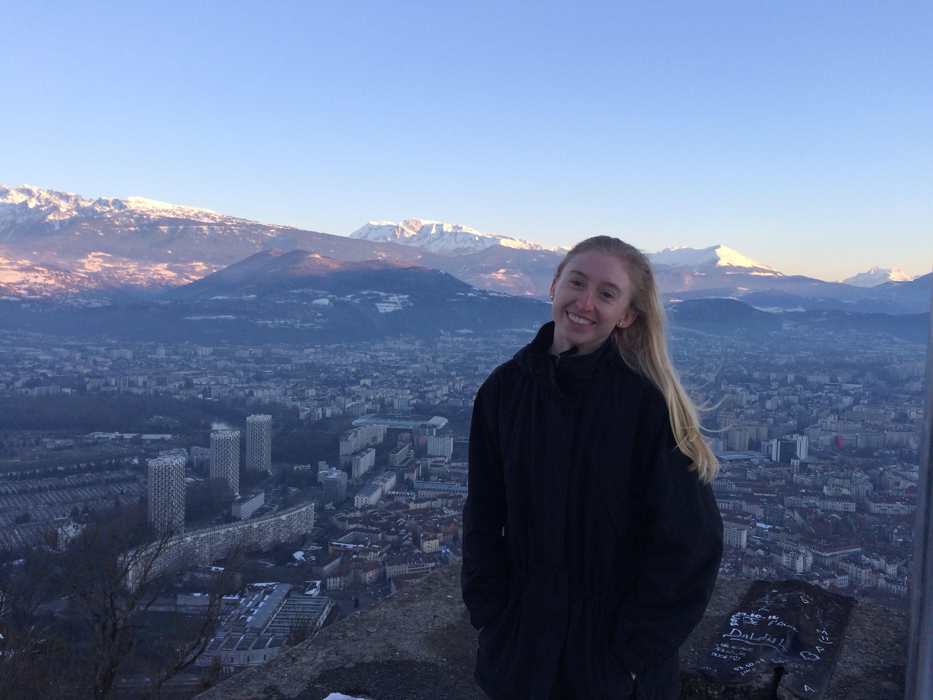 This image shows Grenoble, the beautiful Alpine city in the Southeastern part of France, that I spent 5 months living in. This photo was taken about a month after living there, after overcoming all the hardships of the first month abroad. In this photo, I am comfortable and happy. I climbed a mountain for a breathtaking view and the experience abroad made me feel more grateful, confident, and alive.